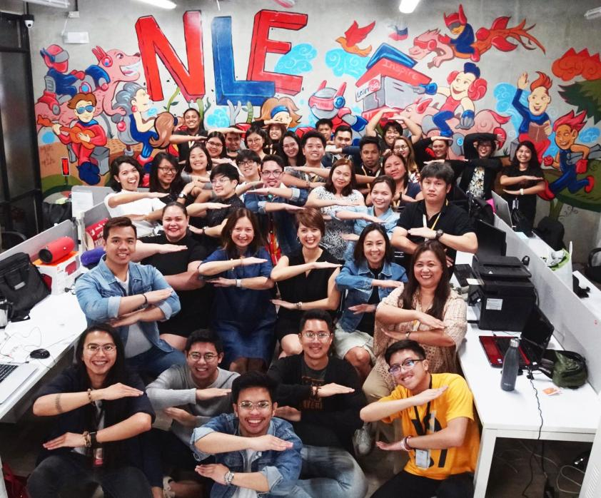 TeamAsia celebrating Women's Month by showing a sign of solidarity for equality